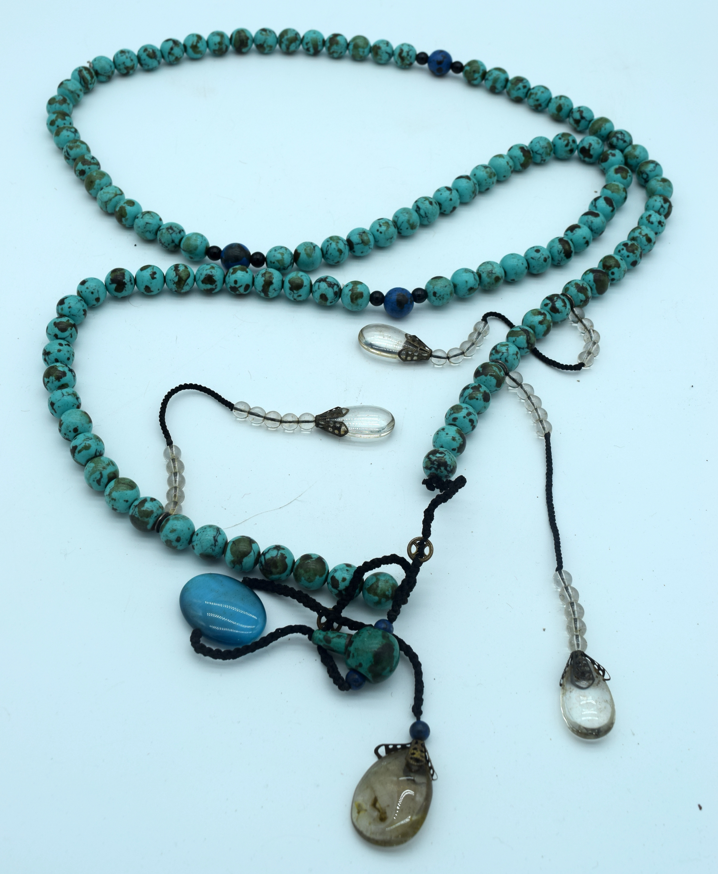 A long Turquoise stone necklace with hanging glass pendants 170cm.