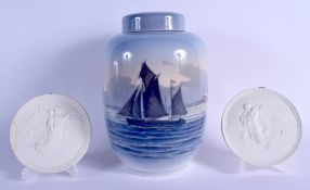 A LARGE ROYAL COPENHAGEN PORCELAIN JAR AND COVER together with a pair of bisque porcelain plaques. L