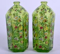 A SMALL PAIR OF LATE 19TH CENTURY CONTINENTAL ENAMELLED GLASS BOTTLES painted with birds. 9 cm high.