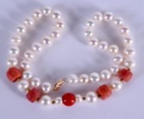 A 14CT PEARL AND CORAL NECKLACE. 40 cm long.