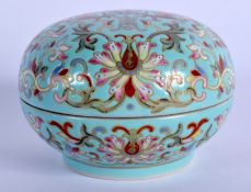 A 19TH CENTURY CHINESE PORCELAIN BOX AND COVER Qing, painted with flowers and vines. 6.75 cm diamete