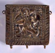 A 19TH CENTURY CONTINENTAL YELLOW METAL SAINT ICON BOX. 61 grams. 5.5 cm square