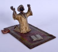 A 19TH CENTURY AUSTRIAN COLD PAINTED BRONZE FIGURE OF AN ARABIC MALE modelled praying. 15 cm x 8 cm.