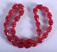 A RUBY NECKLACE. 38 cm long.
