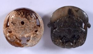 TWO CHINESE JADE ROUNDELS 20th Century. 4 cm x 5 cm. (2)