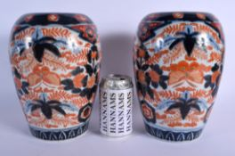 A PAIR OF 19TH CENTURY JAPANESE MEIJI PERIOD IMARI PORCELAIN VASES painted with foliage and insects.