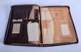 A 1930S ART DECO TRAVELLING LEATHER DOCUMENT FOLDER. 24 cm x 21 cm.
