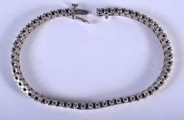 A CHARMING 18CT WHITE GOLD AND DIAMOND TENNIS BRACELET. 15 grams. 20 cm long.