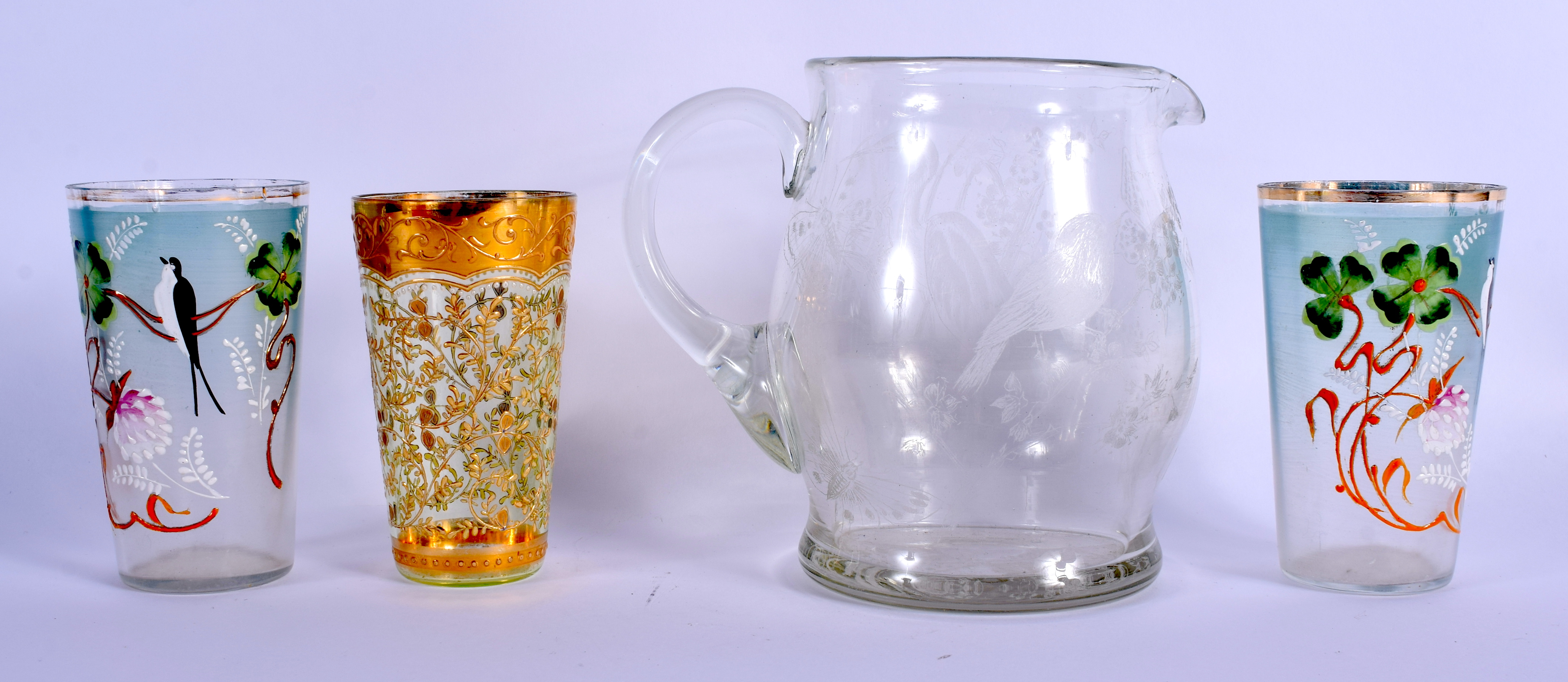 A PAIR OF VINTAGE ENAMELLED CONTINENTAL CUPS together with a jug etc. (4)