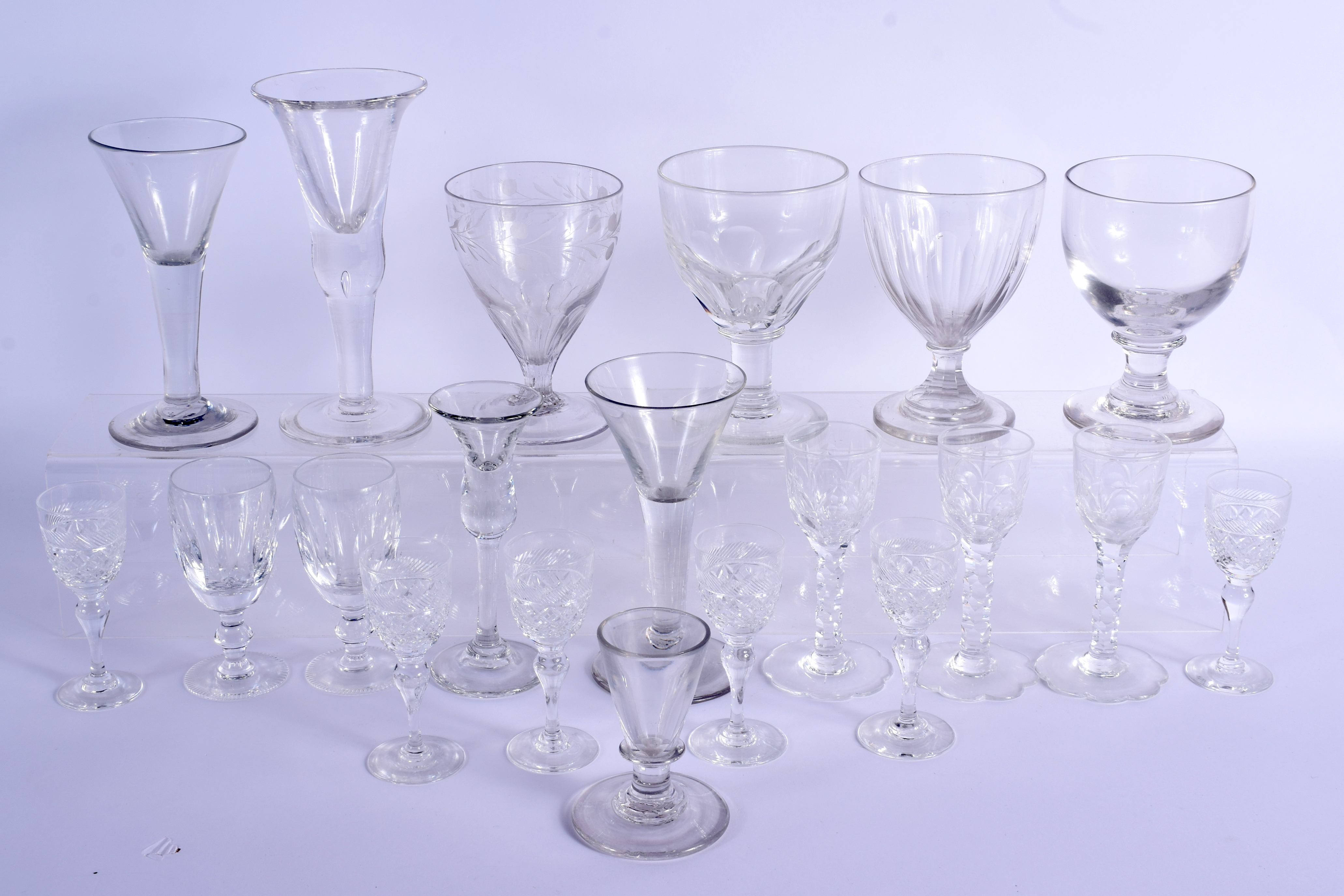 A COLLECTION OF GEORGE III GLASSWARE including rummers, together with later Waterford glasses etc. L