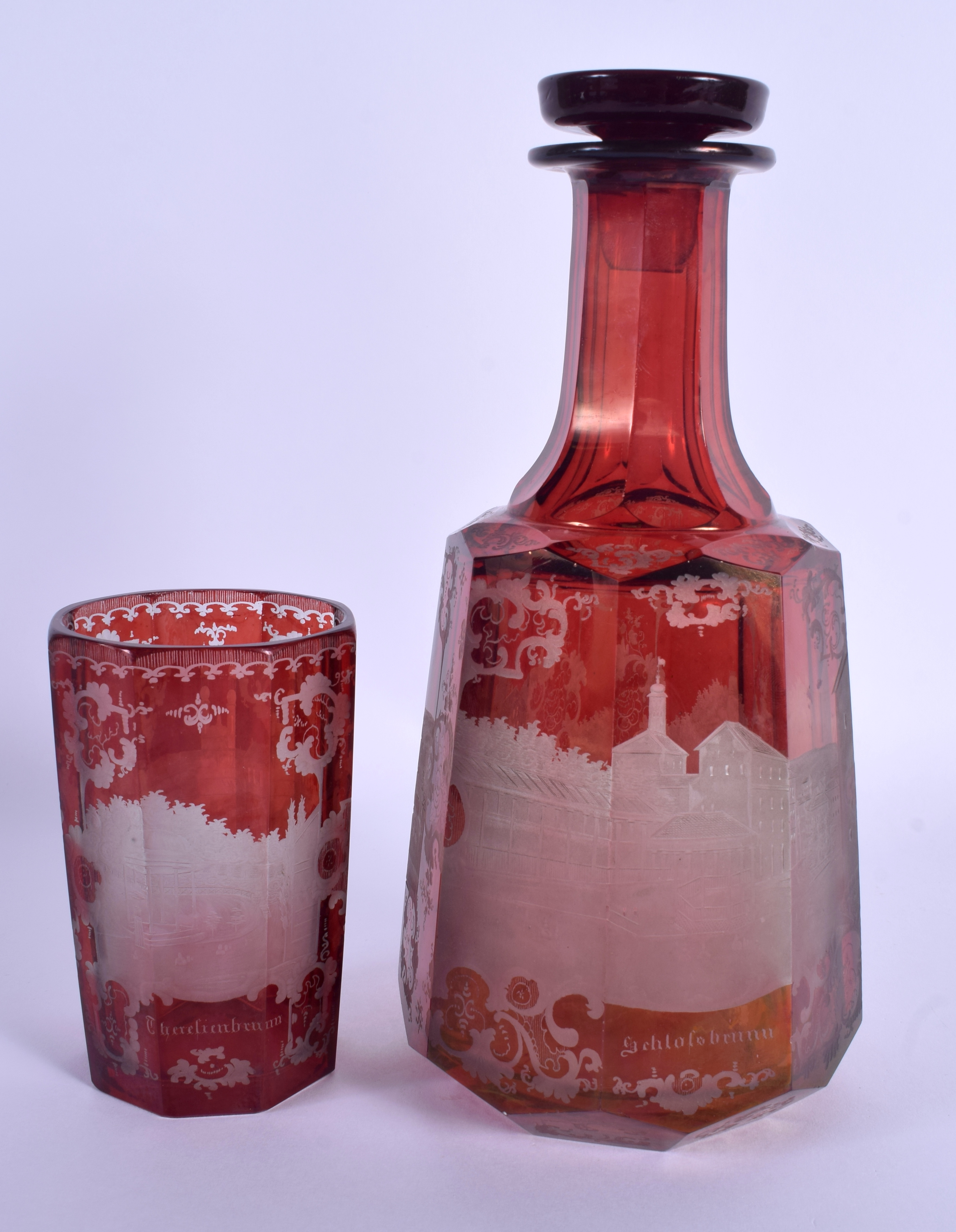 A 19TH CENTURY BOHEMIAN RUBY GLASS DECANTER AND STOPPER together with a similar beaker. 24 cm high.