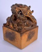 A LARGE CHINESE GILT BRONZE DRAGON SEAL 20th Century. 14 cm x 8 cm.