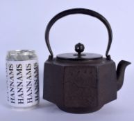 A 19TH CENTURY JAPANESE MEIJI PERIOD CAST IRON AND BRONZE TEAPOT decorated with landscapes. 16 cm x