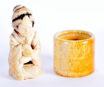A 19TH CENTURY JAPANESE MEIJI PERIOD CARVED IVORY OKIMONO together with a Chinese bone archers ring.