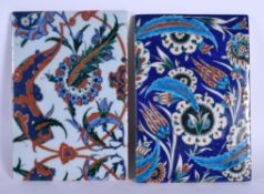 A PAIR OF MIDDLE EASTERN TURKISH IZNIK TILES painted with foliage. 24 cm x 18 cm.