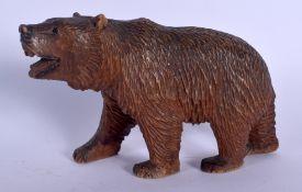 A BAVARIAN BLACK FOREST CARVED WOOD FIGURE OF A BEAR. 14 cm x 11 cm.
