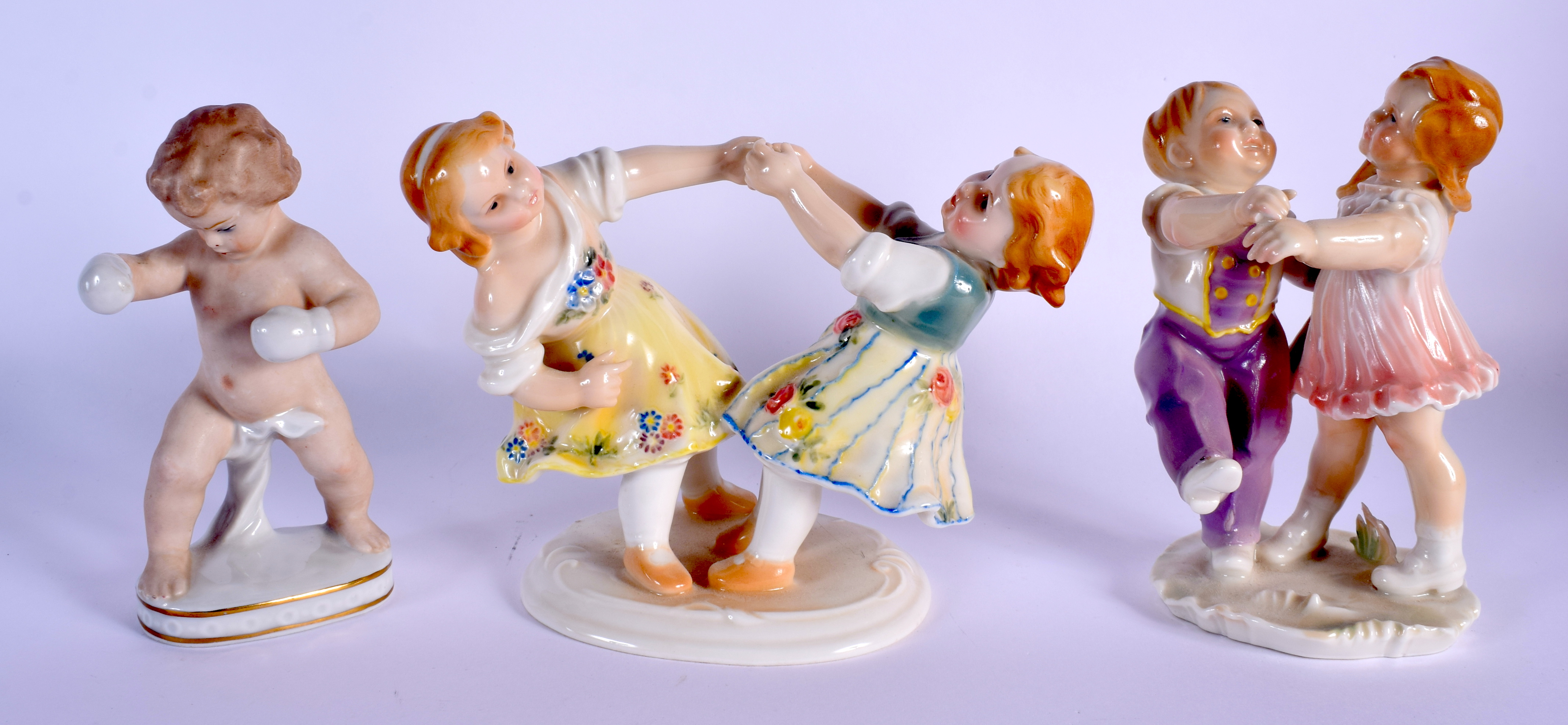 TWO KARL ENZ VOLKSTEDT PORCELAIN FIGURAL GROUPS together with another similar. Largest 14 cm x 14 cm