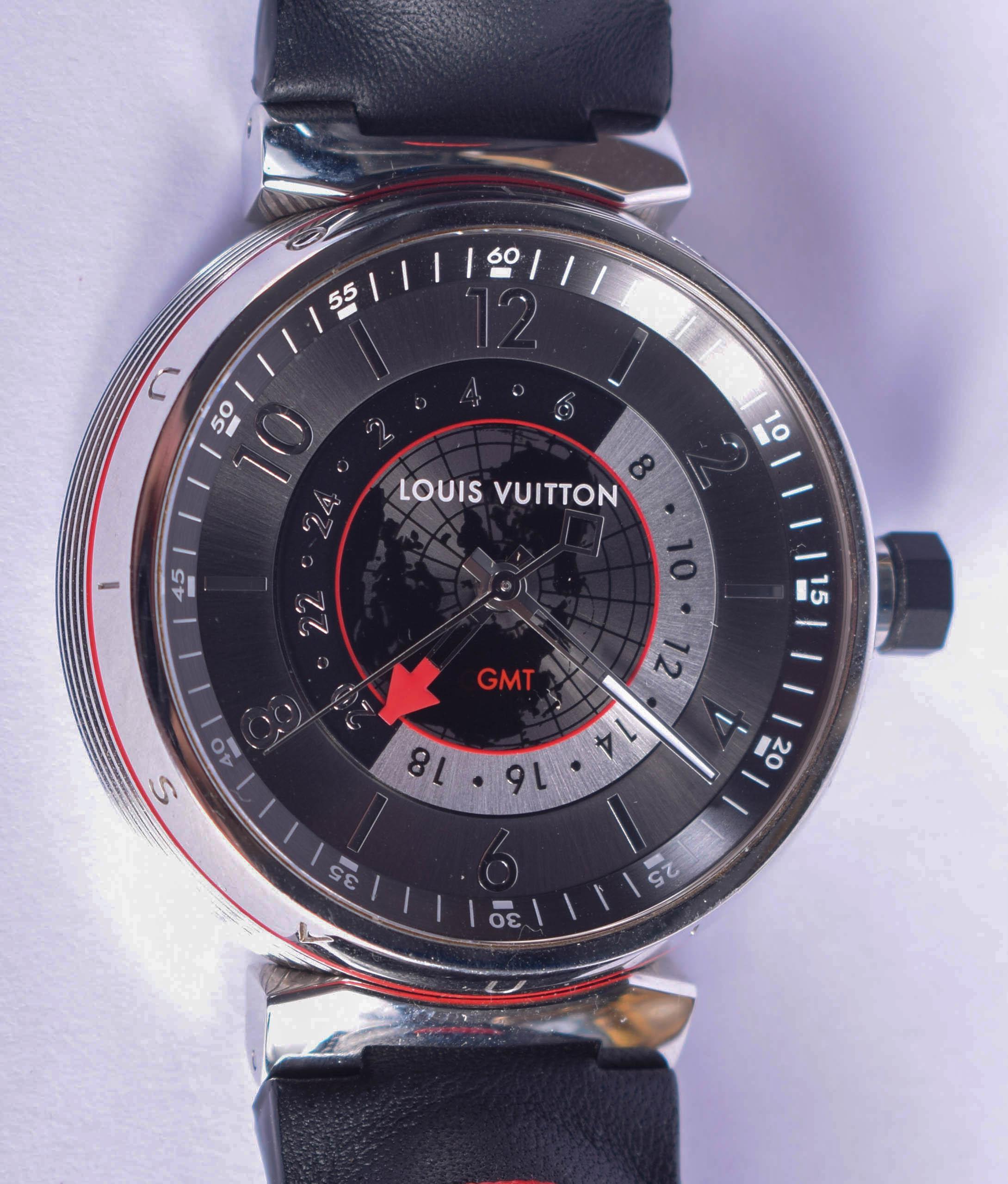 A BOXED LOUIS VUITTON GMT GLOBE WRISTWATCH. 3.5 cm wide.
