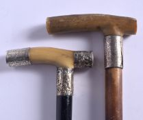 TWO 19TH CENTURY CONTINENTAL CARVED RHINOCEROS HORN HANDLED WALKING CANES. 88 cm long. (2)