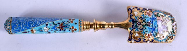 AN UNUSUAL CONTINENTAL SILVER AND ENAMEL SPOON possibly a Cheese scoop, painted with a swan amongst