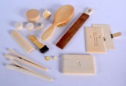 AN ANTIQUE IVORY DRESSING TABLE BRUSH together with a Victorian paperknife etc. Largest 27 cm long.