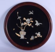 A 19TH CENTURY JAPANESE MEIJI PERIOD BLACK LACQUER SHIBAYAMA PLAQUE decorated with birds amongst fol
