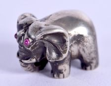 A SMALL CONTINENTAL FIGURE OF AN ELEPHANT. 16 grams. 1.5 cm wide.