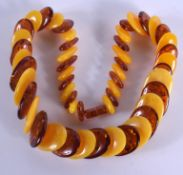 AN AMBER NECKLACE. 132 grams. 54 cm long.