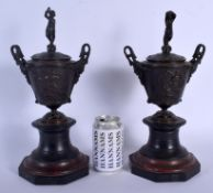 A PAIR OF 19TH CENTURY EUROPEAN GRAND TOUR BRONZES AND COVERS upon red and black marble bases. 34 cm