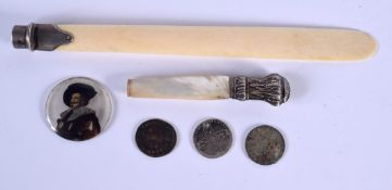 AN ANTIQUE IVORY AND SILVER PAGE TURNER together with a plaque etc. (qty)