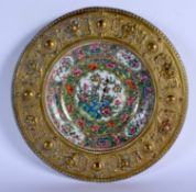 A 19TH CENTURY CHINESE CANTON FAMILLE ROSE PORCELAIN DISH Qing, within a bronze frame. 21.5 cm diame