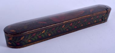 AN ANTIQUE PERSIAN QAJAR LACQUER SLIDING PEN BOX. 17.5 cm long.
