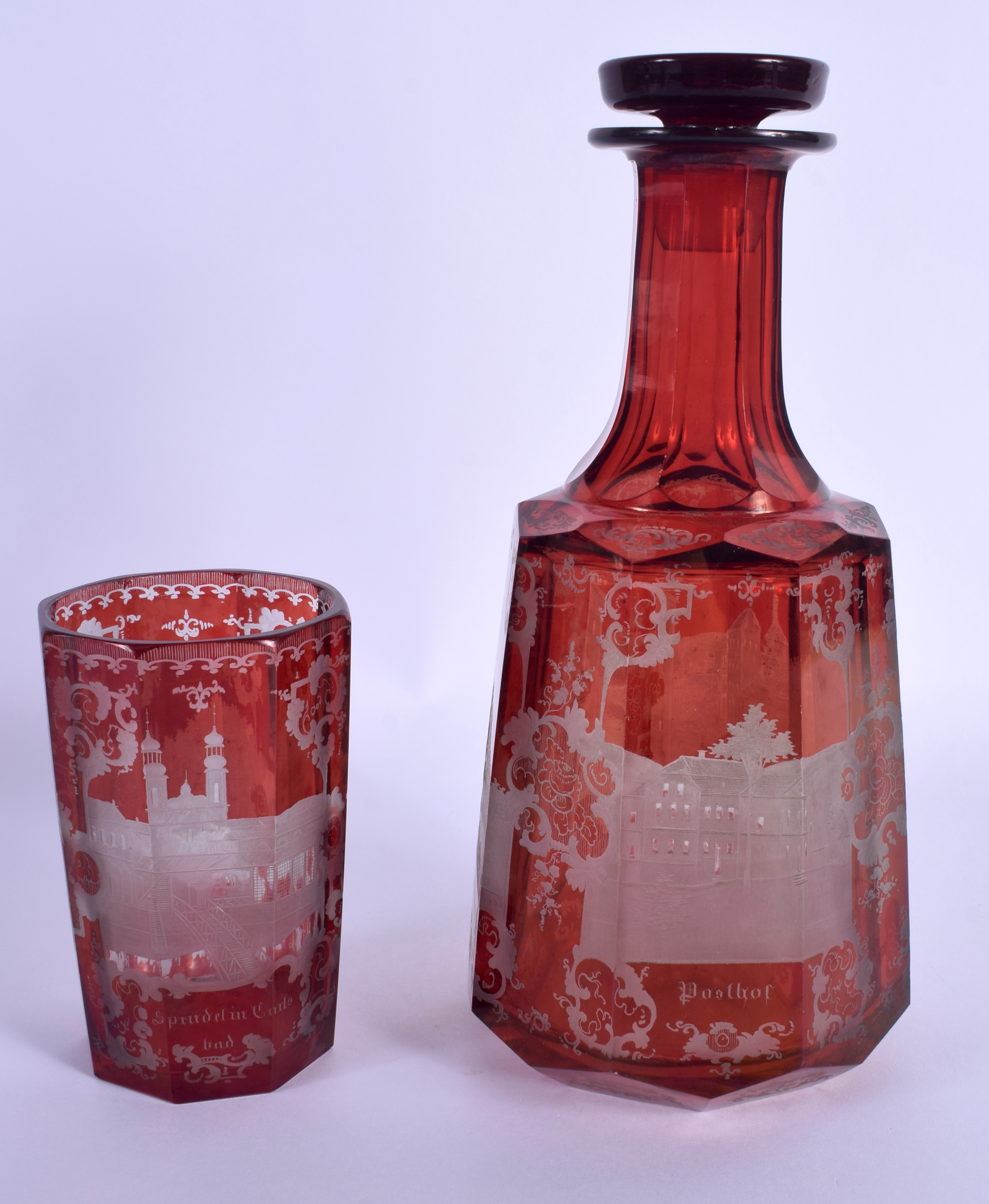 A 19TH CENTURY BOHEMIAN RUBY GLASS DECANTER AND STOPPER together with a similar beaker. 24 cm high. - Image 2 of 3