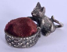 A 1940S SILVER PLATED CAT PIN CUSHION. 4 cm x 2 cm.