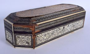 AN 18TH CENTURY INDO PORTUGUESE CARVED IVORY RECTANGULAR BOX engraved with foliage and vines. 29 cm