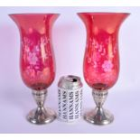 A PAIR OF VINTAGE SILVER MOUNTED CRANBERRY GLASS VASES. 30 cm high