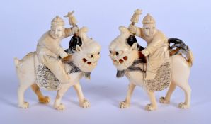 A PAIR OF 19TH CENTURY CHINESE CARVED CANTON IVORY LIONS modelled with attendants. 8.5 cm x 6.5 cm.