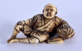 A 19TH CENTURY JAPANESE MEIJI PERIOD CARVED IVORY NETSUKE modelled as a male leaning upon a sack. 4.