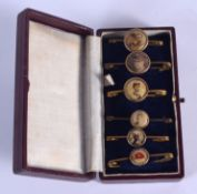 SIX CASED ANTIQUE ENAMELLED PIN BADGES including the Franco British Exhibition 1908. (6)