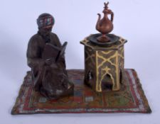 A CONTEMPORARY BRONZE FIGURE OF AN ARABIC MALE modelled upon a carpet. 12 cm x 12.5 cm.