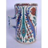 A CONTINENTAL IZNIK TYPE FAIENCE POTTERY CARAFE JUG painted with stylised flowers and vines. 21 cm h