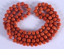 AN 18CT GOLD EUROPEAN AND CORAL NECKLACE. 150 grams. Each strand 122 cm long.