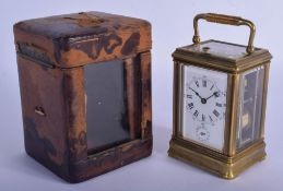 A 19TH CENTURY FRENCH BRONZE REPEATING ALARM CARRIAGE CLOCK with unusual engraved coronet glass top.