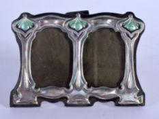 A SILVER AND ENAMEL FRAME. 9 cm x 7 cm.