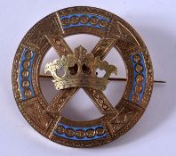 A LOVELY ANTIQUE YELLOW METAL AND ENAMEL BROOCH formed with a central coronet. 15 grams. 4.75 cm dia