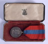 AN ELIZABETH II SILVER MEDAL presented to Harold Rother. 2.5 cm wide.
