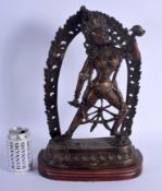 A LARGE EARLY 20TH CENTURY INDO TIBETAN NEPALESE BRONZE BUDDHA modelled in front of a flaming surrou