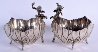 A PAIR OF EARLY 20TH CENTURY SILVER CHERUB BOWLS formed as open flowers. 640 grams. 13 cm x 15 cm.