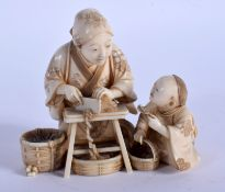 A FINE 19TH CENTURY JAPANESE MEIJI PERIOD CARVED IVORY OKIMONO modelled as a female and child prepar