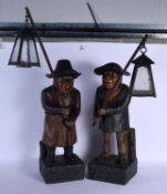 A LARGE PAIR OF ANTIQUE EUROPEAN PAINTED TERRACOTTA FIGURAL LAMP LIGHTERS possibly Scottish, modelle